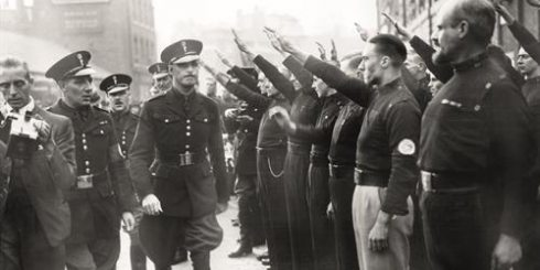 Oswald Mosley is saluted by members of his British Union of Fascists before beginning the march to Cable Street