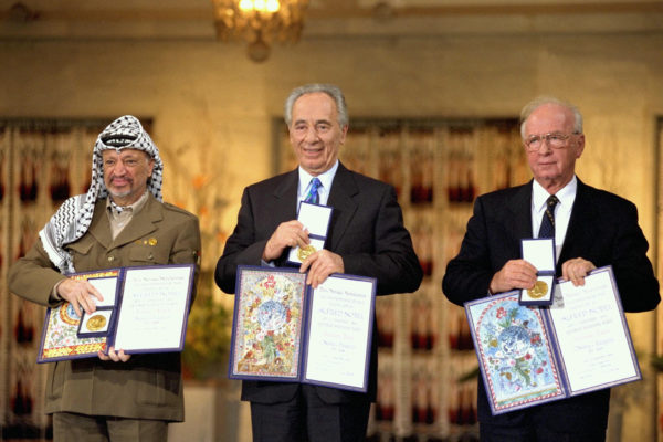 Yasser Arafat, Shimon Peres and Ytzhak Rabin receive the Nobel Peace Prize following the Oslo Accords